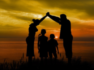 Photo of a family watching the sunset