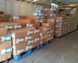 Photo of food boxes stored in a warehouse