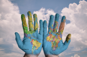 Photo of hands painted with a map of the world