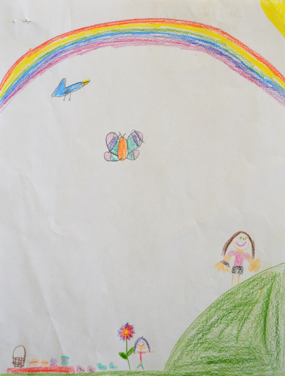 Kid Drawing of rainbow during picnic