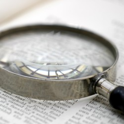Picture of a magnifier over a piece paper with text on it